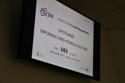 tablica informująca o spotkaniu informacyjno-konsultacyjnym dotyczącym Jednolitego Systemu Antyplagiatowego w Ośrodku Przetwarzania Informacji - Państwowym Instytucie Badawczym